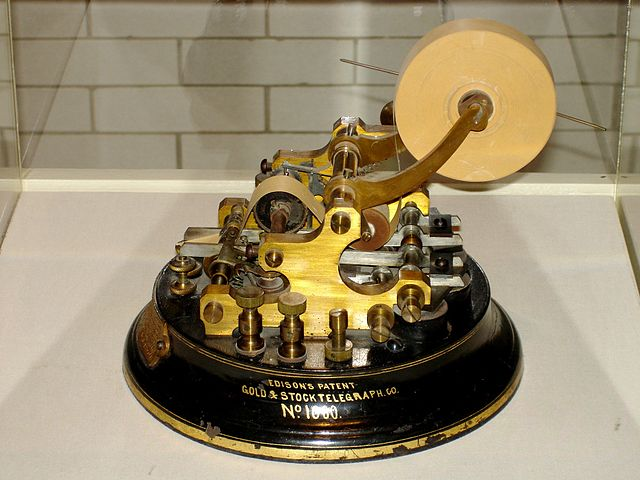 Edison_Stock_Telegraph_Ticker_By_H._Zimmer_(Own_work)__[CC-BY-SA-3.0_(http_creativecommons.org_licenses_by-sa_3.0)]_via_Wikimedia_Commons